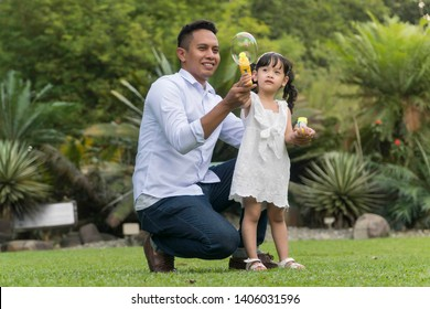 Father and daughter at recreational park having fun