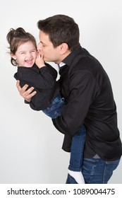Father and daughter relations kiss play and smile in studio