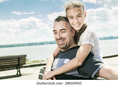 Father daughter sit sea