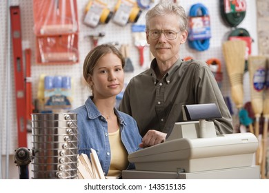 Father and daughter smiling in hardware store
