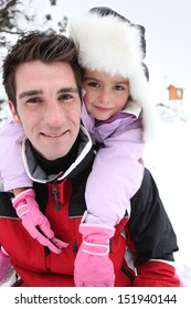 Father and daughter in the snow