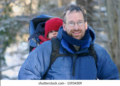 Father and daughter in a snow shoes hike