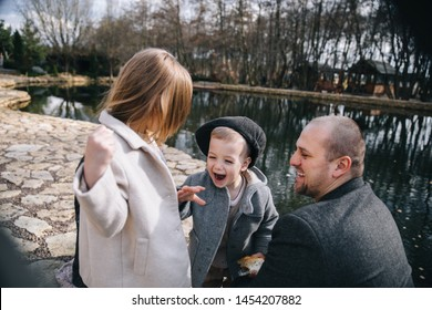 Father with daughter and son having fun spending time together outdoors.