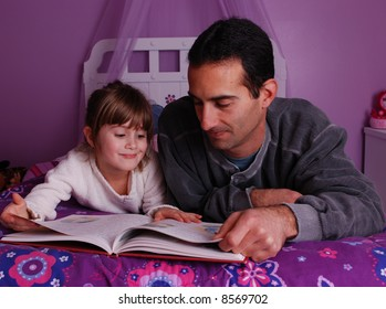 A father and daughter spend time together reading a  book