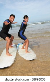 Father and daughter surfing in the ocean