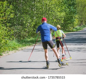 Father and daughter training on the roller skaters.