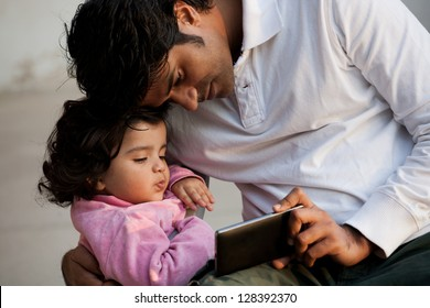 father and daughter using PC tablet, Indian man with his daughter