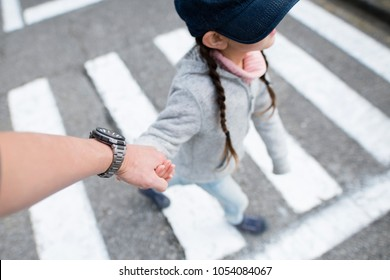 Father and daughter walking hand in hand