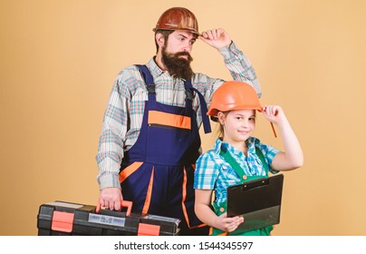 Father and daughter in workshop. Bearded man with little girl. construction worker assistant. Builder or carpenter. Repairman in uniform. Engineer. Repair. Childrens creativity. team at work.