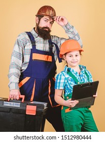 Father and daughter in workshop. Repairman in uniform. Engineer. Bearded man with little girl. construction worker assistant. Builder or carpenter. Childrens creativity. they need a little break.
