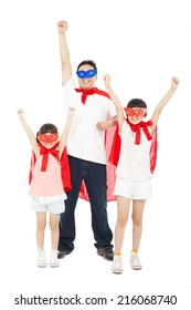 Father and daughters making a superhero pose with red cape . isolated on white background