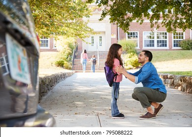 Father Dropping Off Daughter In Front Of School Gates