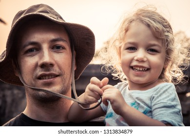 Father embracing beautiful smiling kid daughter portrait vintage style sunlight concept happy parenting lifestyle