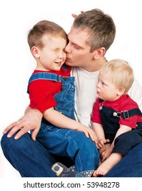Father embracing competitive children on white background