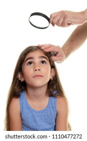 Father examining his daughter's hair looking for lice - Isolated on white