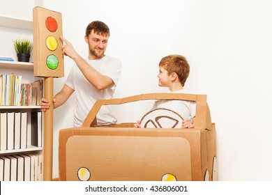 Father explaining traffic regulations to his kid