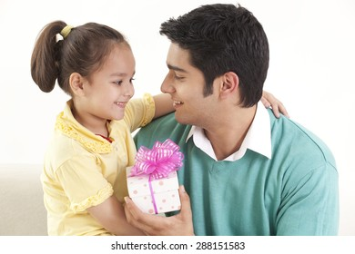 Father giving gift to his daughter