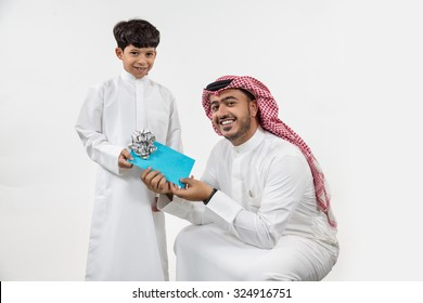 Father giving gift to his son
