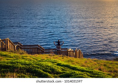 Father giving his son piggyback ride at Hallett Cove boarwalk while enjoying sunset, South Australia