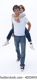 Father giving son piggy back ride against white background