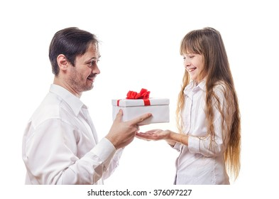 The father grants to the daughter a long-awaited gift in a white box with a red bow