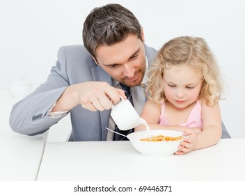 Father having breakfast with her daughter at home