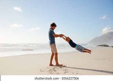 Father Having Fun With Son On Summer Beach Vacation