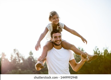 Father Having Good Time with Kid on Meadow