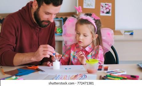 father help children art handmade concept. family values. talented little girl. rich imagination.