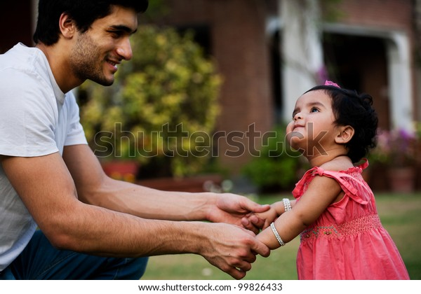 father helping his daughter to take first step of life