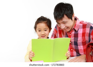 father helping his daugther doing homework