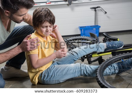How To Catch Falling Son >> Father Helping Wounded Son Getting Falling Stock Photo Edit Now