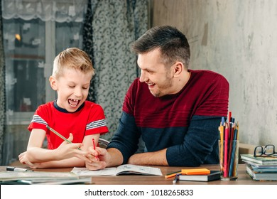 The father helps his son to do homework
