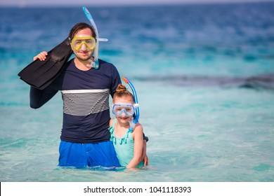 Father and his adorable little daughter at beach