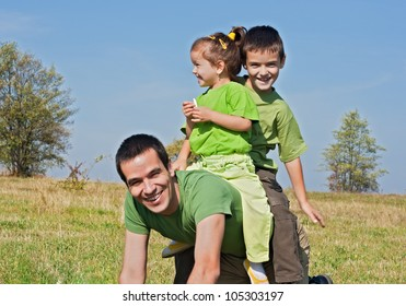 Father and his children playing outside