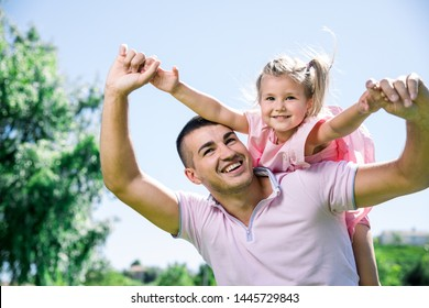 Father with his daughter having a good time together