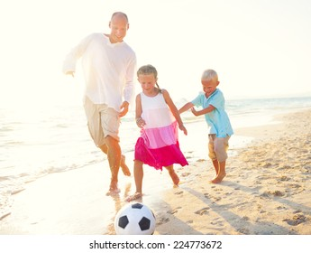 Father and his kids playing football together.