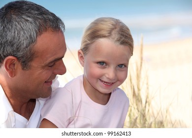 father and his little girl on the daughter beach