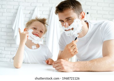 Father and his little son shaving together