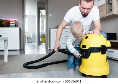 The father and his a small, two years old son are preparing to common cleaning the apartment where they live. Education of the child in the form of fun.