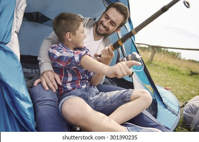 Father and his son fishing on the camping