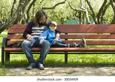 Father and his son on the benches