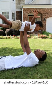 Father and his son playing outside in their yard