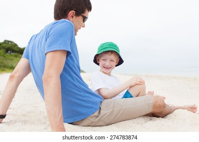 father and his son spending fun day together at the beach at taketomi islands, okinawa, japan