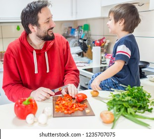 Father and his sons cooking
