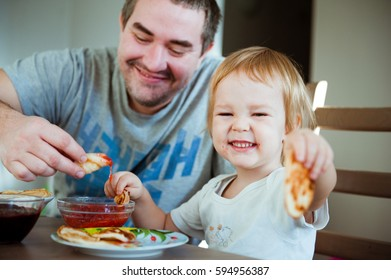 Father and his young son having Breakfast together.