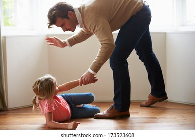 Father Hitting Young Daughter