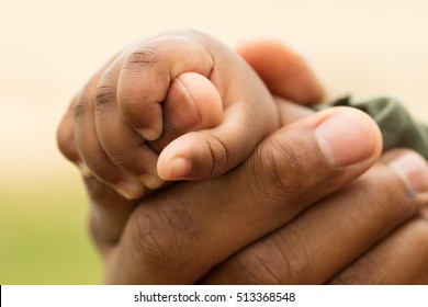 Father holding his daughter's hand.