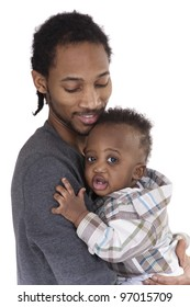 father holding son in his arms  on white background