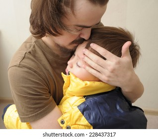 father hugging son, family love concept,  fatherhood child care, parent holding child